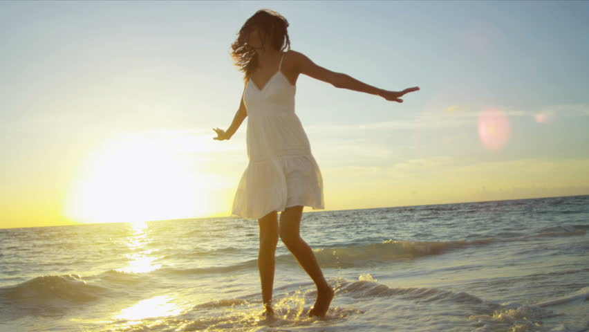 Pretty girl in sundress reveling being alone by ocean at sunrise on beach vacation shot on RED EPIC #3789734