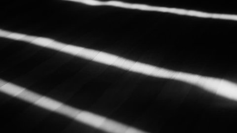 Shadows of Blinds on Bed
