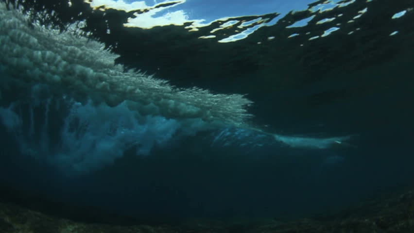 Underwater angle of tropical blue ocean wave  breaking  | Shutterstock HD Video #3816974