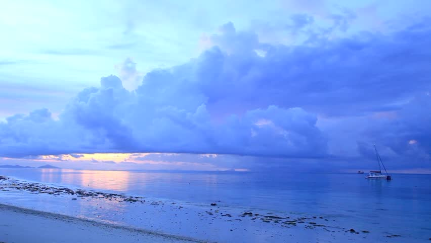 Dramatic, early morning clouds over ocean  | Shutterstock HD Video #3817094