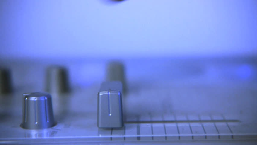 Close up of DJ adjusting controls on mixing board | Shutterstock HD Video #3819584
