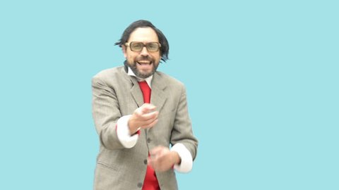 An untidy bizarre ridiculous man, wearing glasses, laughing out loud, over light blue background