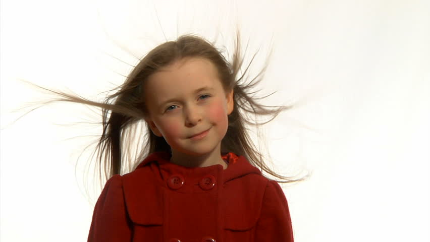 Windswept child - Little girl's long hair being blown around in the wind.