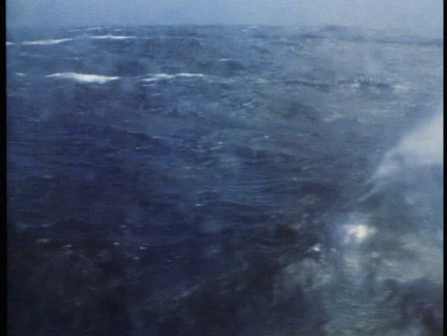 POV out porthole of QE2 in very rough, huge, seas, ship rolling badly