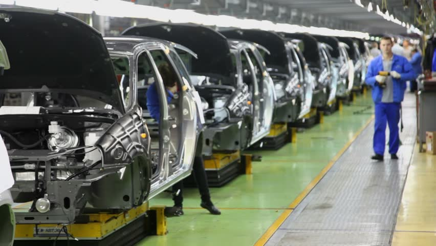 TOGLIATTI - SEP 30: People work at assembly of cars Lada Kalina on conveyor of factory AutoVAZ, (focus on first car) on September 30, 2011 in Togliatti, Russia. AvtoVAZ factory was founded in 1966