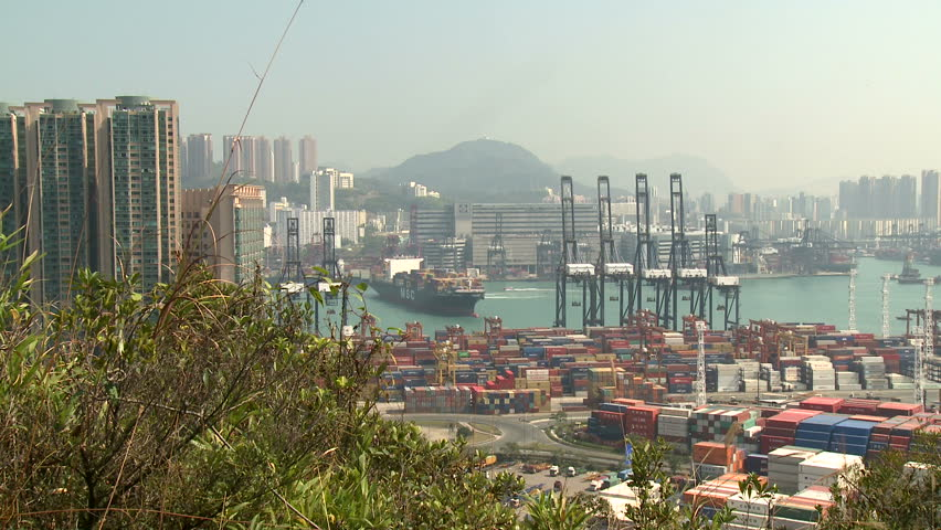 HONG KONG, CHINA - AUGUST 2012: Container Ship Maneuvering In Port Wide Shot. Shot overlooking Hong Kong container terminal in full HD on Sony EX1.