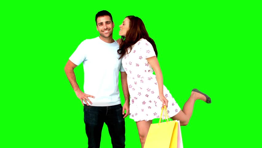 Man being kissed by his girlfriend because he gave her a gift on green screen in slow motion