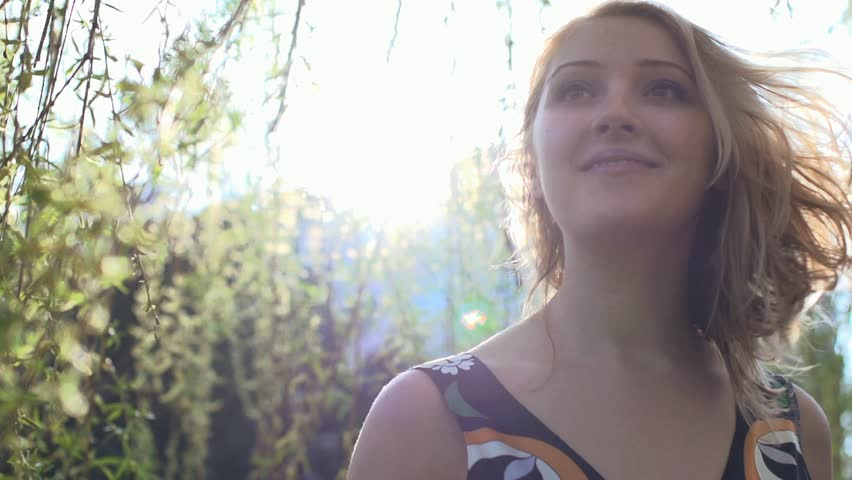 Happy lifestyle background. young women enjoying springtime outdoors. spirit energy. sun. sun flare. lens flare. beautiful. colorful. touching nature. female single person | Shutterstock HD Video #3878957