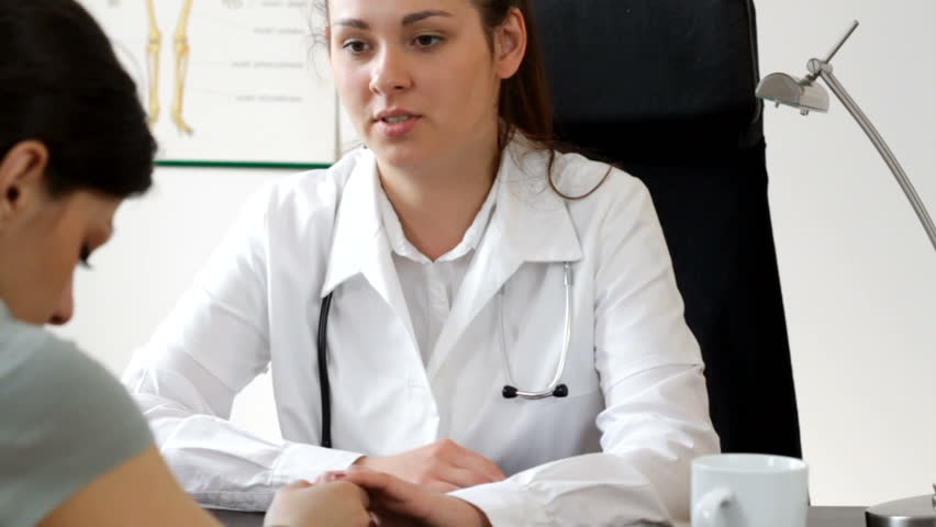 Female doctor comunicate bad news - tracking shot