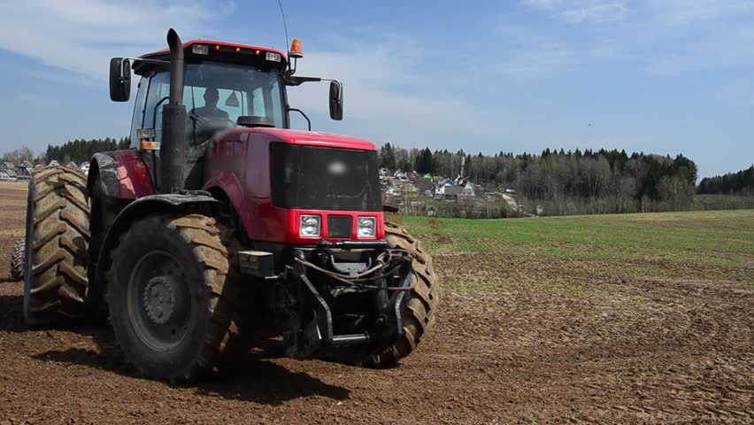 Sowing campaign. Tractor sowing wheat. Tractor sowing cereals. Agricultural machinery for planting cereals