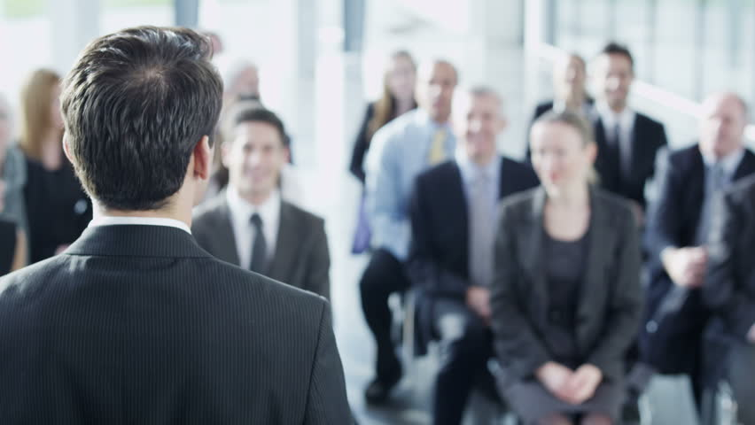 A diverse group of business people of mixed ages are listening to a presentation at a business seminar and asking questions. In slow motion.    Shutterstock HD Video #3895604