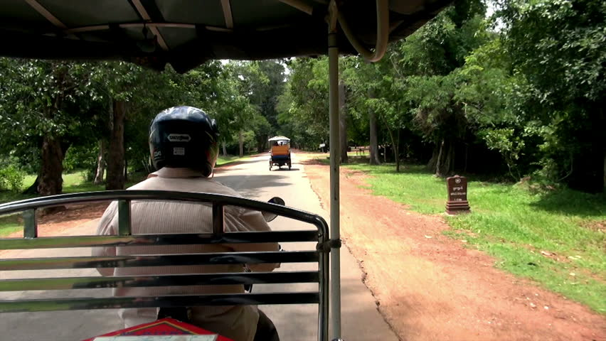 road trip in Siem Reap with one of traditional means of transport, tuk-tuk / tuk-tuk tour in Cambodia