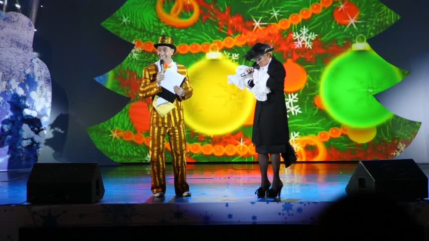 MOSCOW - JAN 04: Actors performing a kids show on stage at Forum Hall New Year masquerade of the Moscow families on Jan 04, 2012, Moscow, Russia