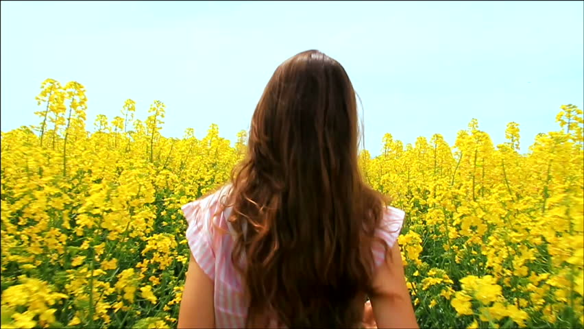 Young Woman in Vintage Dress Running through Yellow Field Touching Flowers HD | Shutterstock HD Video #3913772