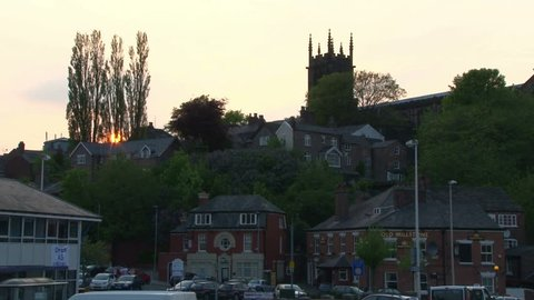 CHESHIRE, UK - AUGUST 2012:A church on a hill with the sunset through the trees.