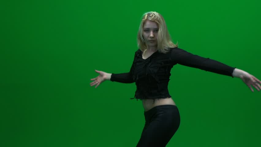 sexy women dancer. dancing sexy. black dressed. isolated against green  screen. female performer. dance moves. music background