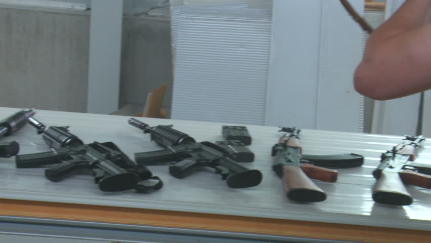Russian Dealer checking AK 47