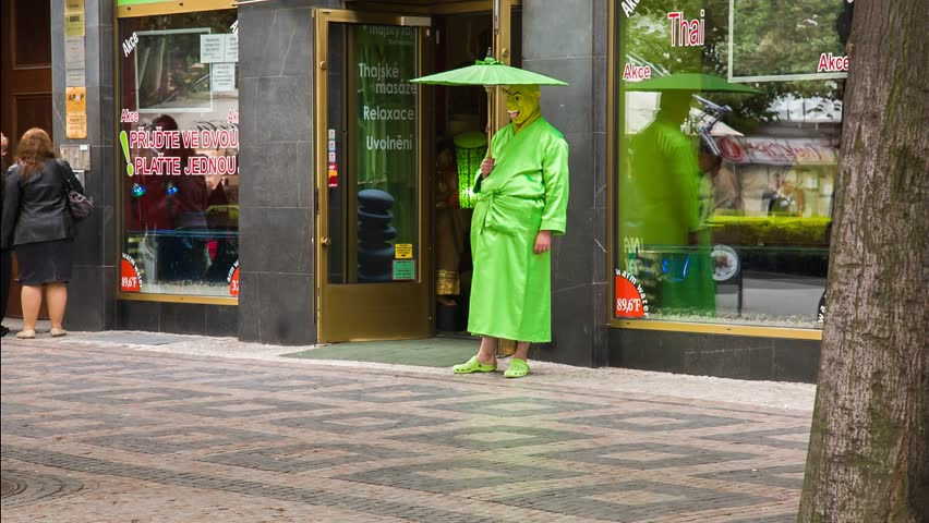 PRAGUE, CZECH REPUBLIC - MAY 21, 2013: Man dressed as Shrek is standing in front of the thai massage in Prague