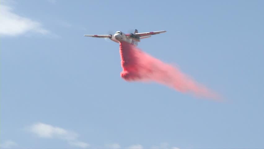 Air Tanker Drops Red Fire Retardant On Brush Fire