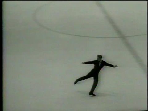 French figure skater Alain Calmat performs during IX Olympic Winter Games in Innsbruck, Austria circa 1964-MGM PICTURES, UNIVERSAL-INTERNATIONAL NEWSREEL, USA, filmed in 1964
