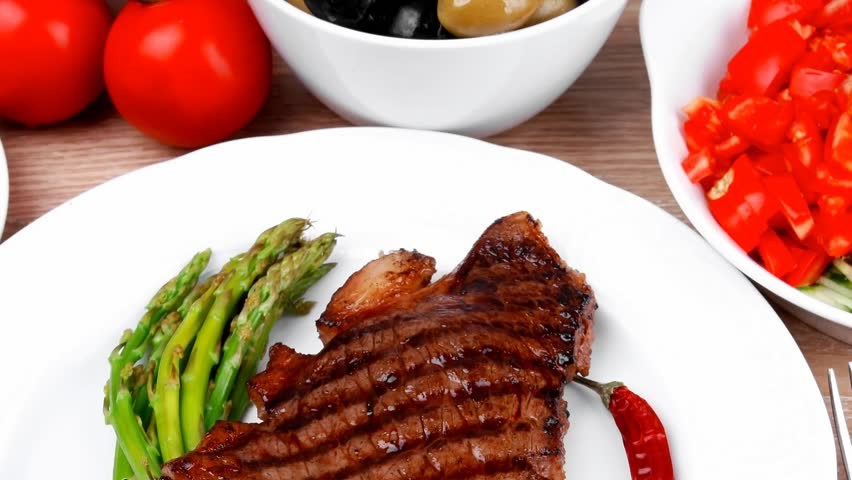 Meat Table Grilled Beef Fillet With Asparagus Pasta Portion Tomatoes And Several Kinds Of Olives