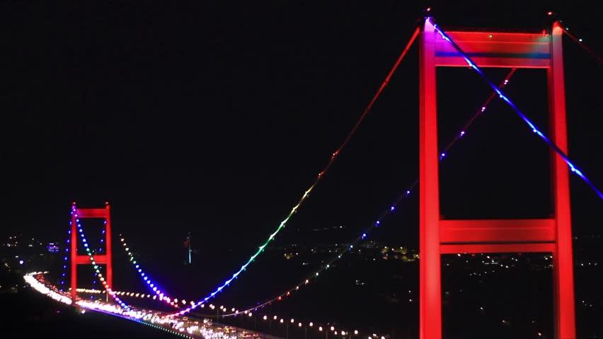 Istanbuls second bridge nightly light show. Colorful lighting of FSM bridge.