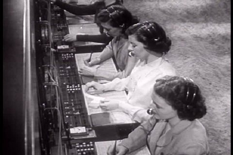1940s - Telephone switchboard operators in 1949.