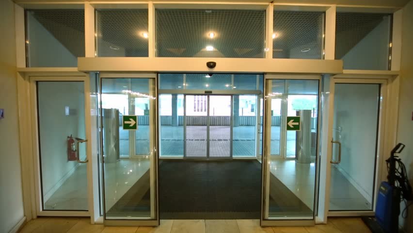 Walk through entrance automatic glass door of office building stock walk through entrance automatic glass door of office building stock footage video 4035604 shutterstock planetlyrics Image collections