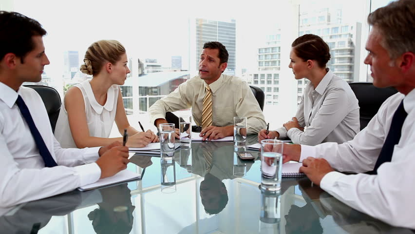 Businessman talking to colleagues taking notes in the office | Shutterstock HD Video #4049677