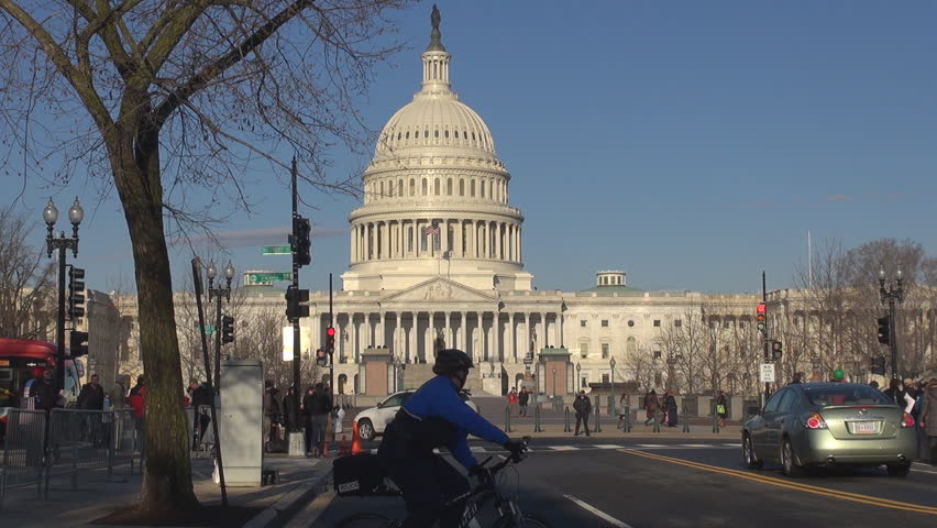 WASHINGTON DC - USA, MARCH 25, 2013, Streetlife and The United States Capitol building by day