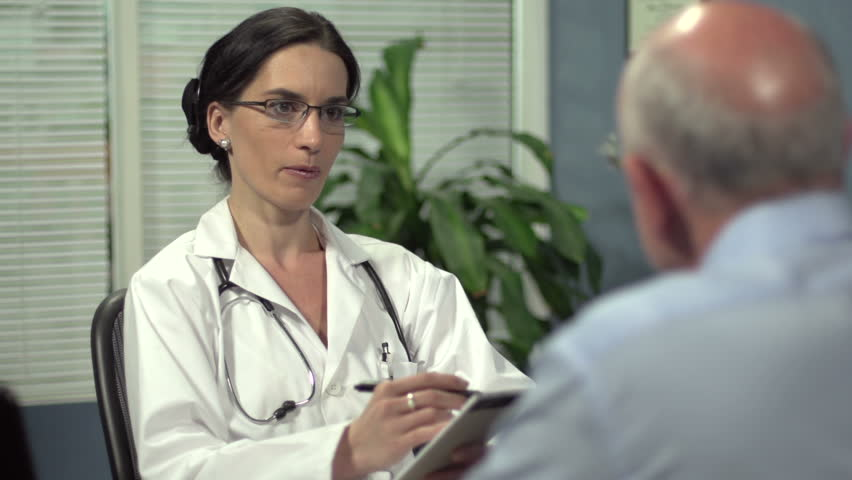 Female doctor consulting with senior patient | Shutterstock HD Video #4073284