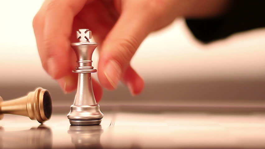 Chess. Move decisive checkmate. Gold (money)is not always the most valuable. Decide whose side you are!