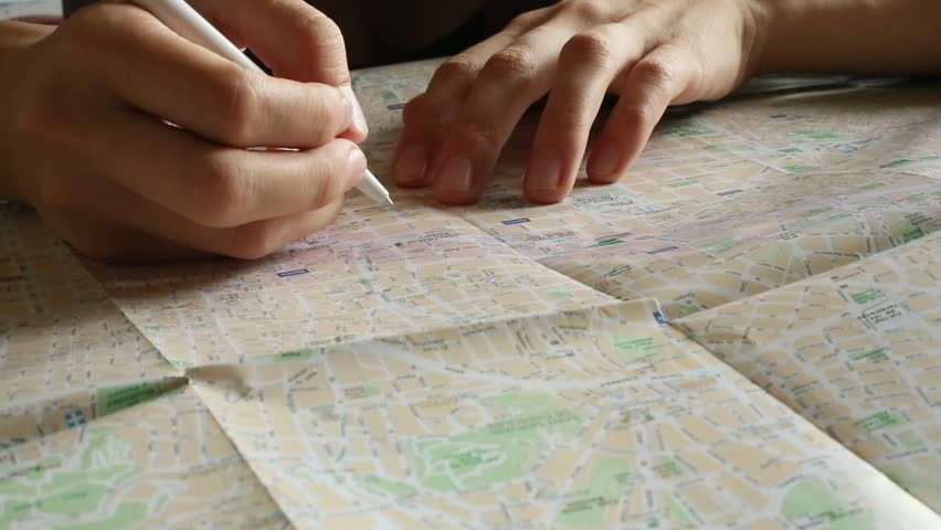 Hand makes notes in pencil on the map (HD)