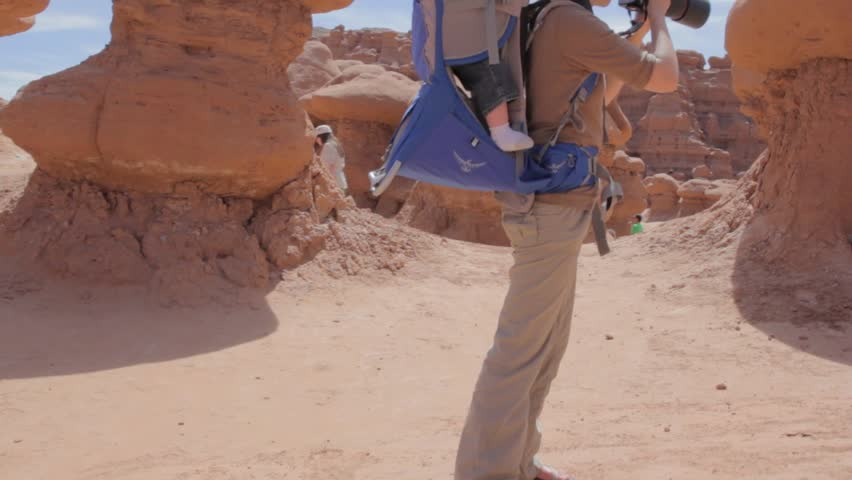 A photographer taking pictures in Goblin Valley State Park | Shutterstock HD Video #4119454