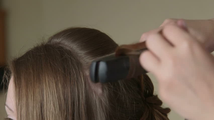 Young woman getting hair style at hairdresser