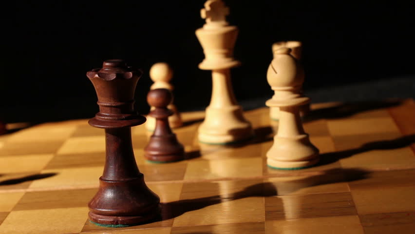 Wooden Chess Pieces on Board