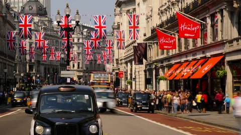 LONDON - CIRCA 2012 - London, Regent Street, Decorated with Union Jack Flags marking the Royal Wedding of Prince William and Kate Middleton, London Taxi and Buses. Time lapse T/L