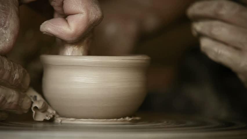 Old Potter works in workshop