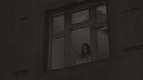 Horror Scene of a Scary Female Ghost at the Window