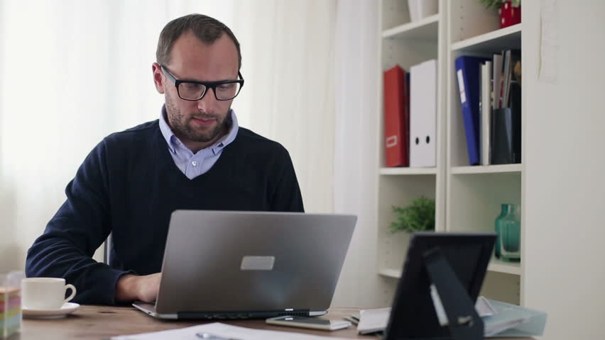 Businessman working on laptop computer in the office