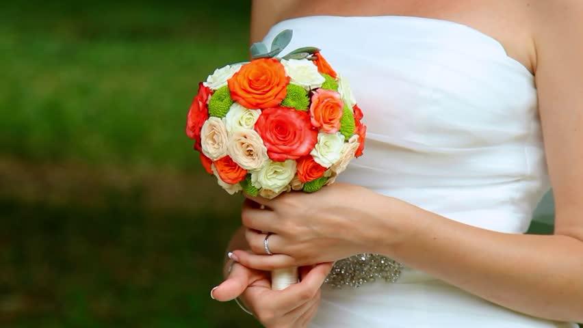 wedding flowers in bride`s hands