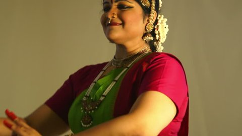 A lovely young woman storytelling with mudra or hand gestures traditional to classical Indian dance.