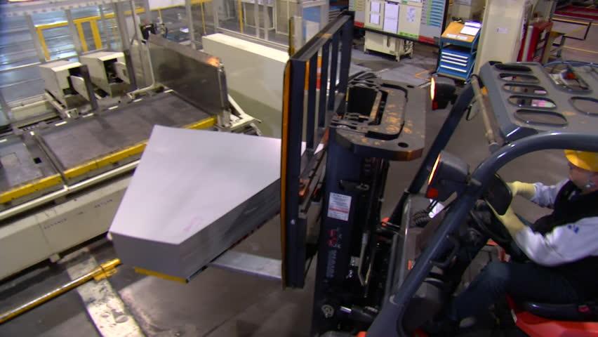 Pressing sheet metal in automotive factory   Shutterstock HD Video #4202824