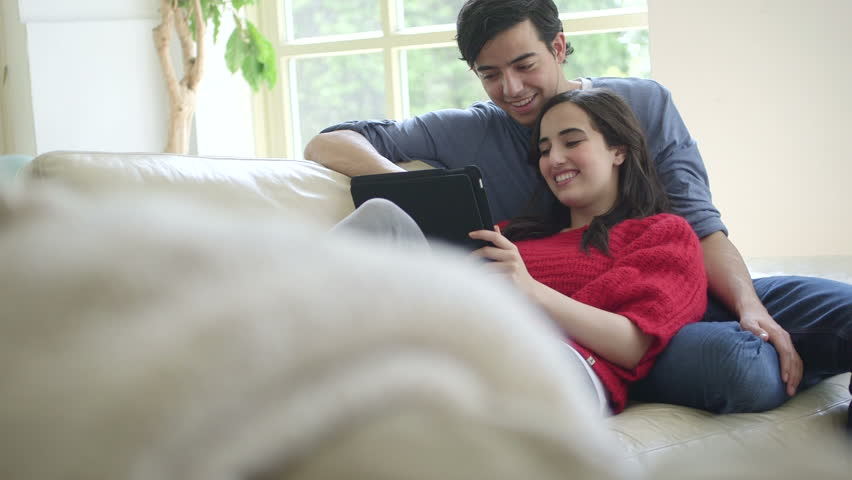 Young Couple Cuddling On Sofa Stock Footage Video (100% Royalty Free)  4206274 | Shutterstock