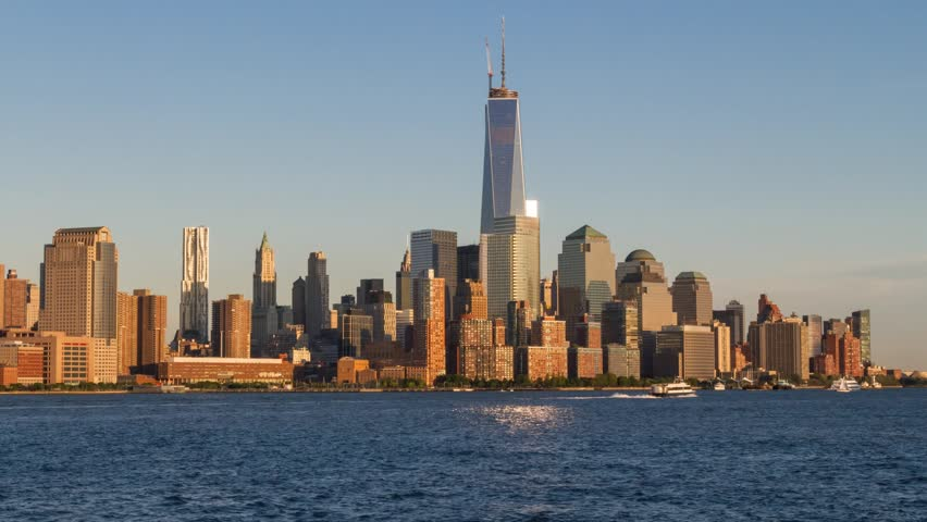Time lapse of day changing to night over the Freedom Tower and Downtown Manhattan as seen across the Hudson River from Hoboken, NJ in June of 2013. #4215370