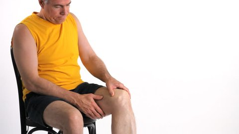 A man who is experiencing severe pain in his knee.