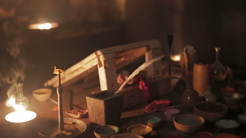 Colorful powder to make potions in a witch lab at candlelit