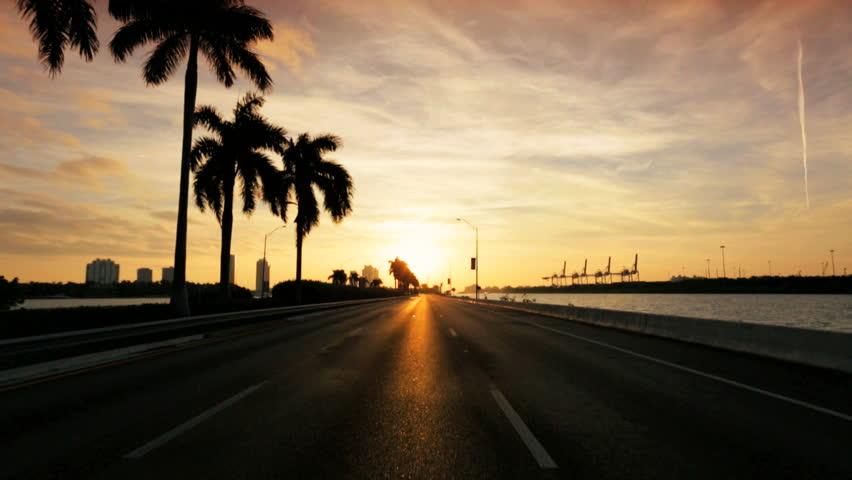 P.O.V. driving sunset Ocean Causeway highway Miami City, Florida, USA