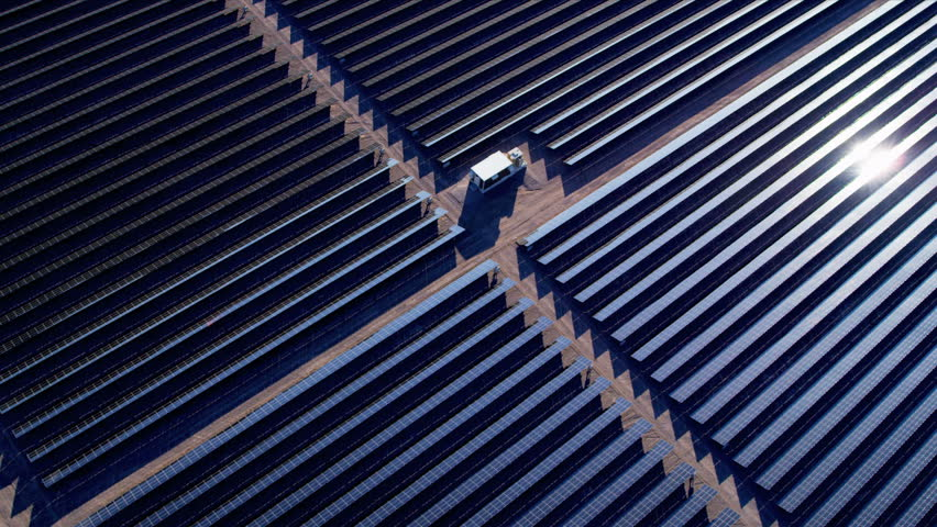 Aerial view large industrial Solar Energy Farm producing concentrated solar energy, USA,
