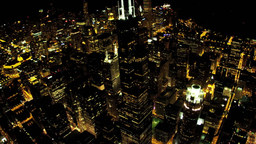 Aerial illuminated view city skyscrapers at night Willis Tower, avenues of light, Chicago, Illinois, USA, shot on RED EPIC